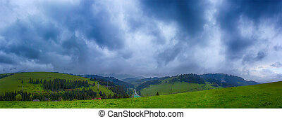 Mountain with green hills and pine trees on the slopes of a cloudy overcast