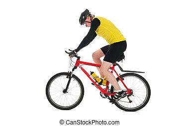 Mountainbiker in studio - Active mountainbiker rides in...