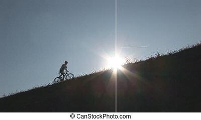 mountainbiking up hill wide