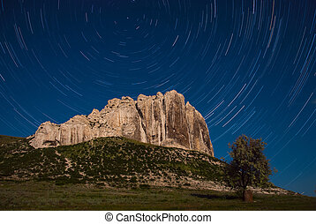 Mountaine and startrails in sky