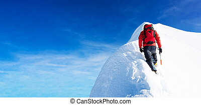 Mountaineer arrive to the summit of a snowy peak. Concepts: determination, courage, effort, self-realization.
