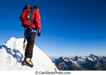 Mountaineer on a snowy ridge
