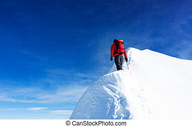 Mountaineer reach the summit of a snowy peak. Concepts: determination, courage, effort, self-realization.
