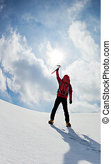 Mountaineer walking uphill along a snowy slope