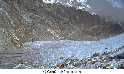 Mountaineers walk through the glacier in the Himalayas....