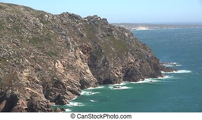 Mountainous Cliffs Along Ocean