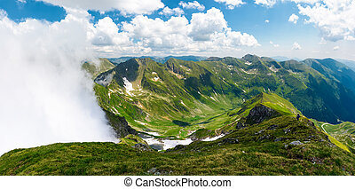 mountainous panorama with rising clouds. beautiful landscape...