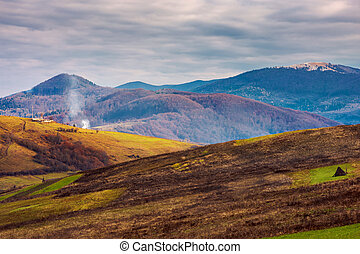 mountainous rural area in deep autumn. empty fields and...