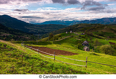 mountainous rural area in springtime. agricultural fields...