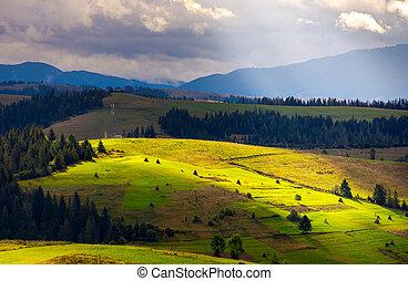 mountainous rural area on a cloudy day. gorgeous light on...