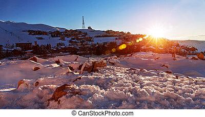 Mountainous village in sunset