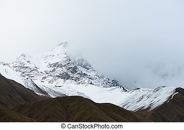 Mountains after snowfall - Mountain landscape. Cloudy day...
