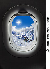Mountains Alps at Austria in airplane window
