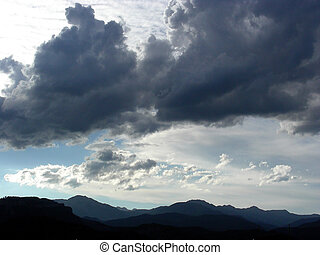 Mountains and Clouds - Layers of mountains beneath the...
