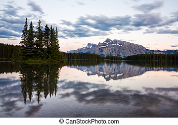 Mountains and forests reflected in Two Jack Lake