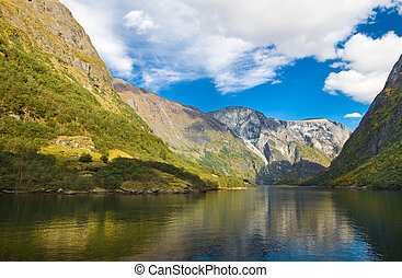 Mountains and norwegian fjord in autumn