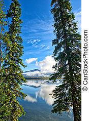 Mountains and reflections of Skilak lake in Alaska