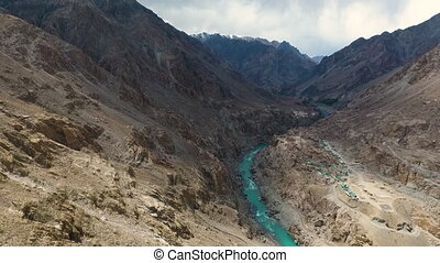 Mountains and River Running Through - Drone, exterior,...