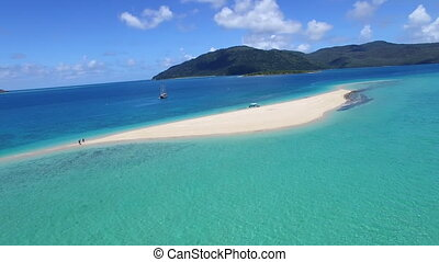 Mountains and sand bay aerial shot - A wide blue ocean and...