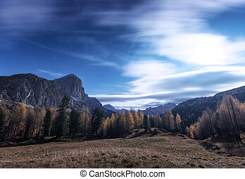 Mountains at beautiful night in autumn in Dolomites, Italy.