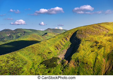 Mountains at sunny bright day in summer. Colorful landscape
