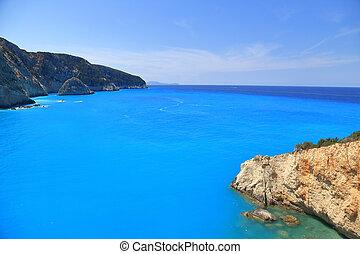 Mountains, cliffs, blue sea and horizon Lefkada Greece