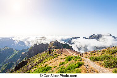 Mountains in clouds - Hiking path in mountains, Madeira