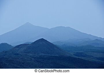 mountains in fog blue