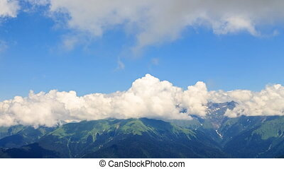 Mountains in the clouds. Panorama. Time Lapse. Sochi,...