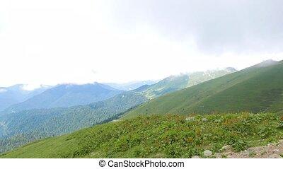 Mountains in the clouds. Ridge Aibga. Sochi, Russia.