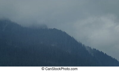 Mountains In The Rain - Rainfall in the mountains on cloudy...