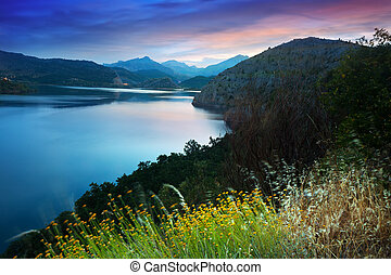 mountains lake in summer sunrise