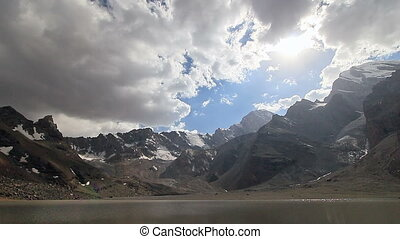 Mountains, lakes and clouds. Muddy Lake, Tazhikistan....