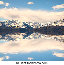 Mountains - Landscape of Alps mountains, with a big cloud on...