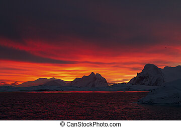 mountains of the Antarctic Peninsula during sunrise