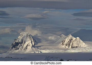 mountains of the Antarctic Peninsula on a cloudy day