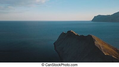 Mountains Peaks, Sunset and sea. Epic on the edge of the...