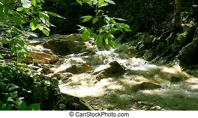 Mountains river. Large stones on a mountain river with clear blue nature water. beautiful