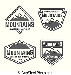 Mountains set of vector four vintage badges