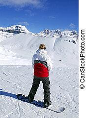 Mountains snowboarding - Girl on snowboard enjoying scenic...