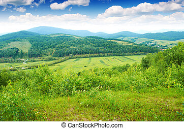 Mountains - The village is in the distance in the European ...
