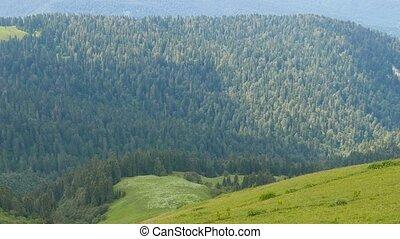 Mountains under clouds in the summer. Ridge Aibga. Sochi,...