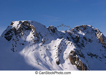 Mountains with a cable car in the far
