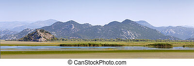 mountains with blue sky near the lake