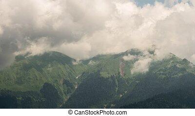 Mountainside in clouds. TimeLapse. Ridge Aibga, Rosa Khutor,...