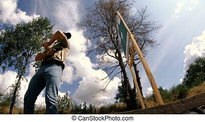 Mounted video. Shooting. A man is practicing tactical shooting with a pistol at a shooting range.