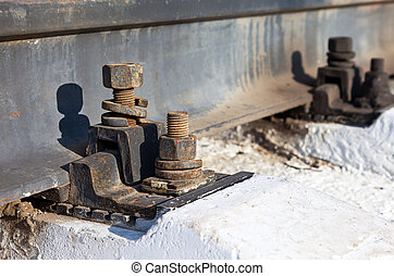 Mounting rails to the sleepers