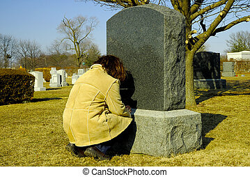 Person Mourning at a Cemetery