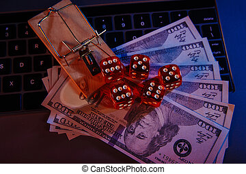 Mousetrap on dollar banknotes and casino dices close-up. Onine gambling addiction.