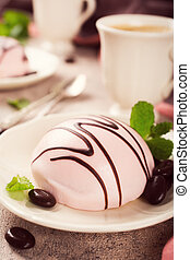 Mousse cakes covered with pink glaze